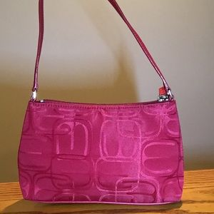"Express Red purse. 9x2x5"". Zip closure."