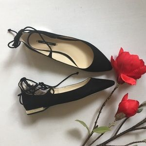 Zara black wrap flats with gold heel.