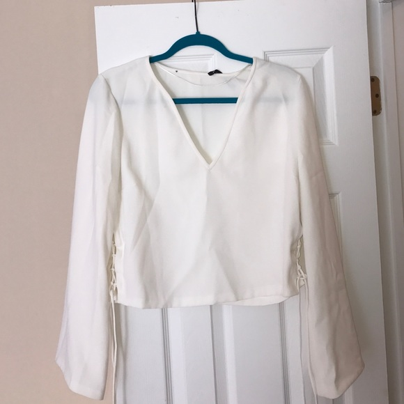 8a96bc143b Zara white v neck top with lace ups on the side