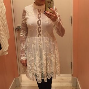Long sleeve lace dress with lace back.