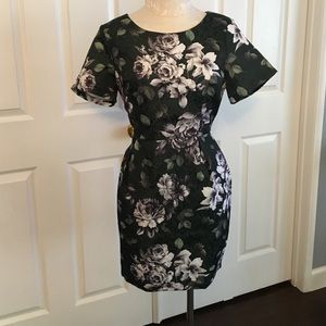 Gray floral print on dark green colored dress.