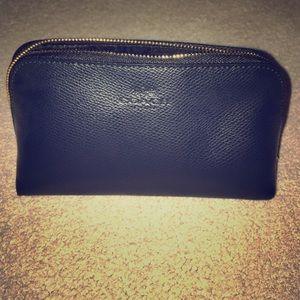 Brand new, never used black Coach make up bag