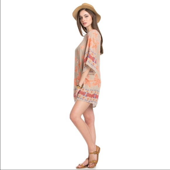 This is a beautiful, form-fitting, women's off shoulder dress with long ruffled sleeves. The elasticized neckline pulls down over the arms, exposing the upper chest, shoulders and upper back.