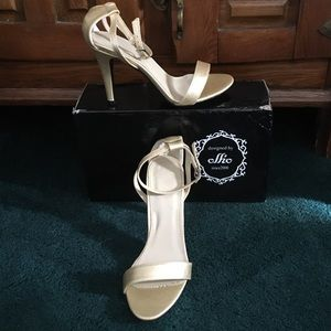 ollio Shoes - Gold Stiletto Heels, never worn. In original box