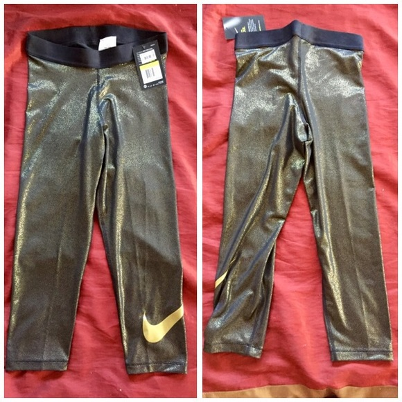 50% off Nike Pants - NWT gold Nike Capri leggings sparkly work out ...
