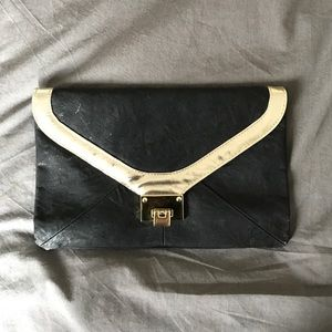 ASOS black clutch with gold trim