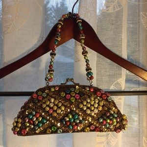 Pocketbook with beaded handle