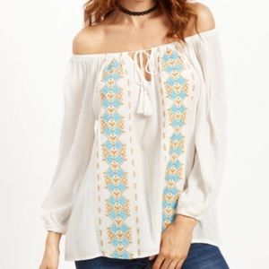 Off the shoulder white peasant blouse. Price firm.