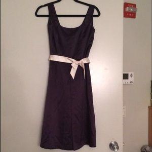 Eggplant satin dress with white sash