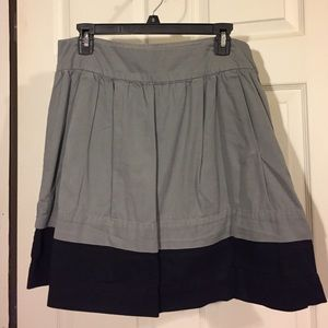 Gray with black pleated skirt