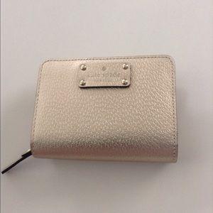 kate spade Handbags - NWT Kate Spade Wellesley Cara Wallet in Rose Gold