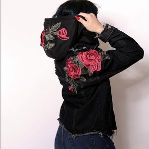 Distressed denim jacket with embroidered roses