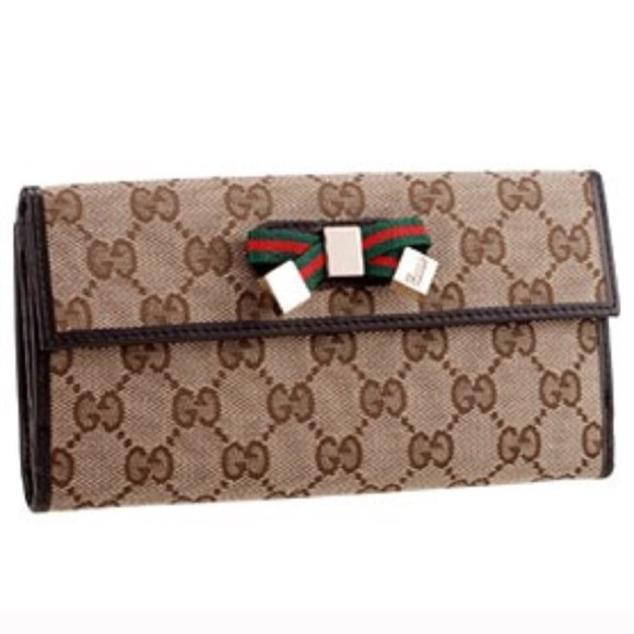 89c3e942354 Gucci Handbags -  Gucci  top continental signature wallet with bow!