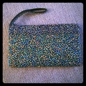 Beaded peacock colored clutch.