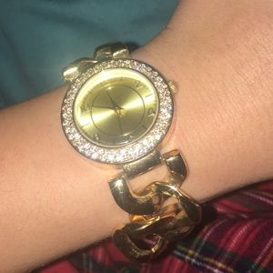 Gold chain necklace and watch