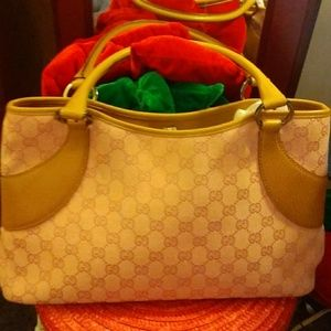Gucci Handbags - Gucci pink logo and trimmed in tan leather
