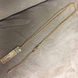 Long gold believe pendant necklace