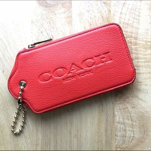 Coach Handbags - COACH Oversized Hangtag Media Case in Coral