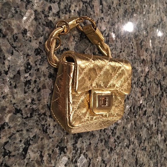 02f55b2842dff4 CHANEL Handbags - Authentic Chanel gold mini micro ankle flap bag