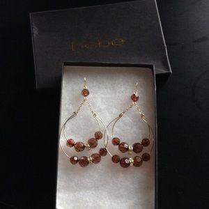 bebe Jewelry - Bebe dangle gold earrings.