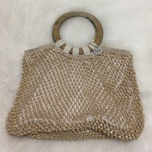 The Sak Original tan beaded purse w/ wood handles