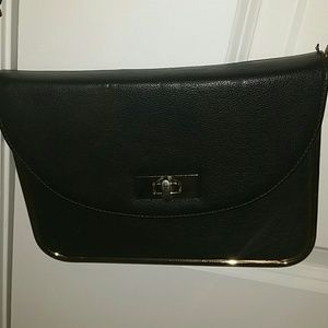 Black mini bag with gold accent