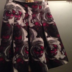 Pleated distorted rose skirt
