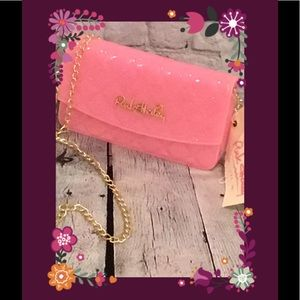 Cross-body bag in light pink by Pink Haley.