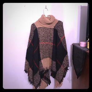 Tan and black sweater poncho