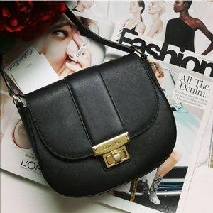 Calvin Klein Handbags - Calvin Klein Black Saffiano Leather Crossbody Bag