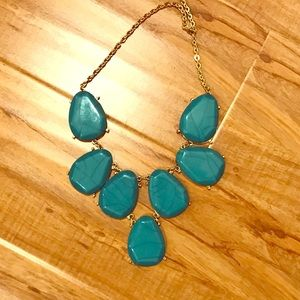 Chunky teal statement necklace.