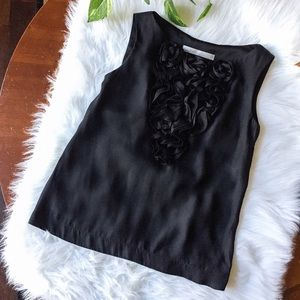 Adorable black sleeveless top with floral details