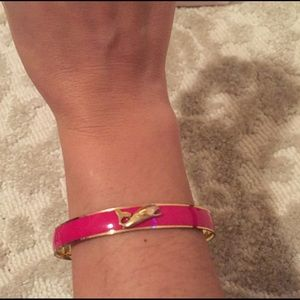 Pink bangle with gold whale