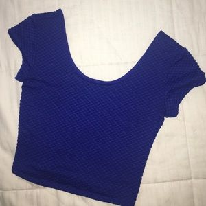 Size small, blue crop top.