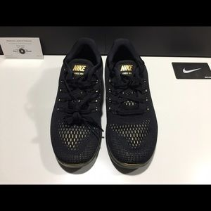 e0adb3009e63 Nike Shoes - Women s Nike Free RN LE Black   Metallic Gold NEW