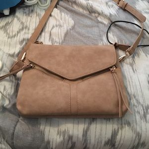 A tan cross body purse