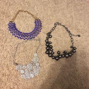 Three short statement necklaces