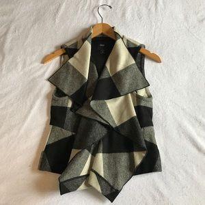 Gap flannel vest.
