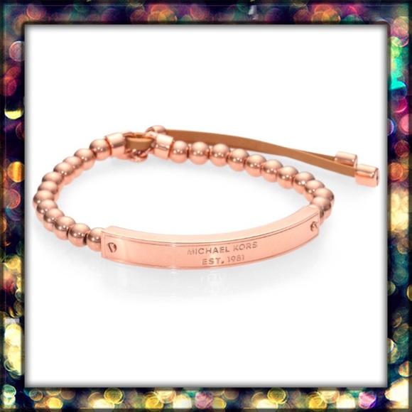 827f46522a205 Michael Kors Heritage Plaque logo bracelet