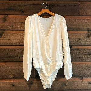 Lovers + Friends Tops - Lovers and Friends plunge bodysuit ivory