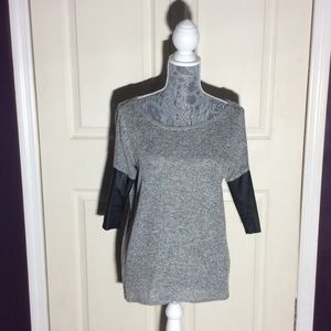 Knit top with faux leather sleeves