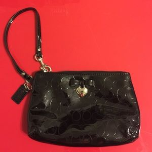 Coach Handbags - Coach shiny black wristlet