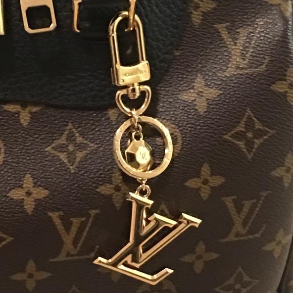 7c90d207fef Louis Vuitton Accessories - LV FACETTES BAG CHARM   KEY HOLDER M65216