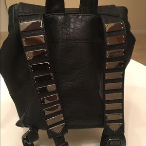 Edgy Faux Leather Backpack