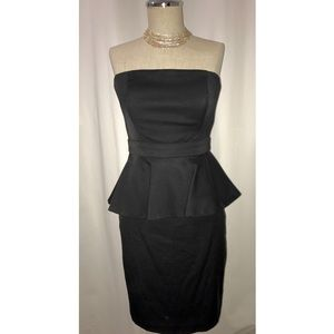 Black peplum strapless dress