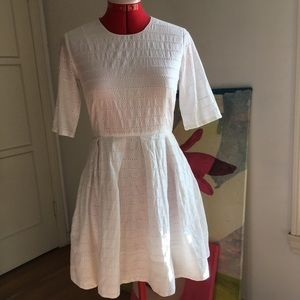 Gap white eyelet dress with pockets.
