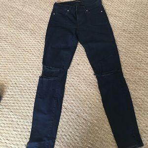 JBrand dark ink stretch skinny jeans with holes.