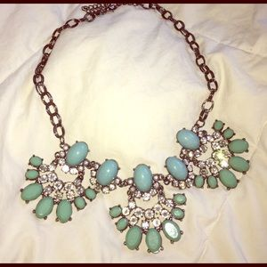 Turquoise colored statement necklace.