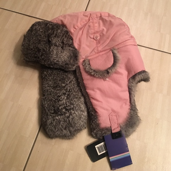 Pink winter hat with fur flaps on both sides 800c1e0897c