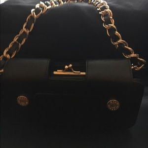 issac mizrahi Handbags - Black hand clutch purse with gold buttons